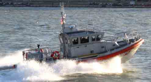 Coast Guard boat returning from harbor duty