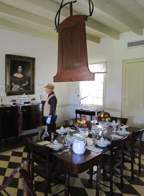 The dining room with large slave operated fan over the table