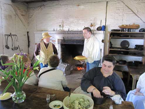 Cooking in the open hearth kitchen