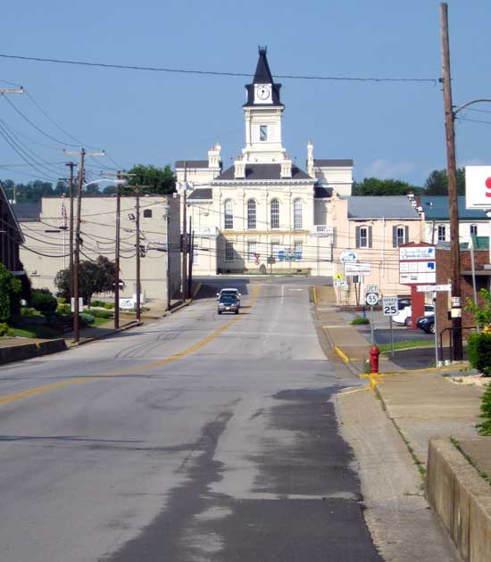 The historical county seat in Columbia, KY; Behind: the new county court house