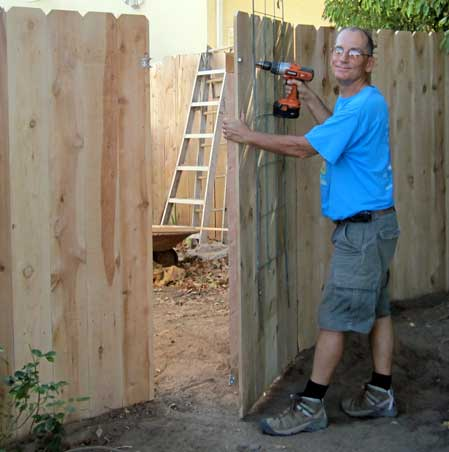 Dale poses with the last screw into the gate