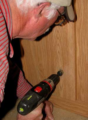 Drilling a hose hole through the cabinet