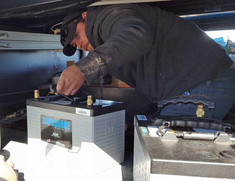 Adrian loads the new Lifeline Batteries into the battery bay