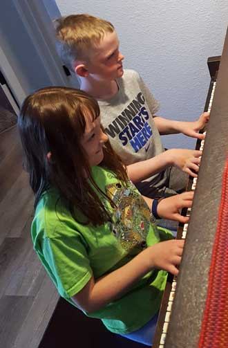 Chloe and Noah practice for a recital