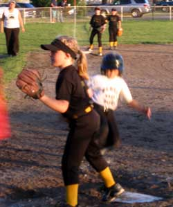 Courtney Scores at home plate