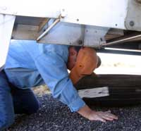 Then you crawl under the trailer and pull out the spare