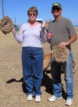 Gwen and Dale get their reward for winning the cow pie contest