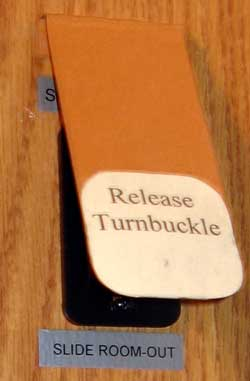 Release Turnbuckle Warning Sign over switch