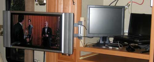 TV Located left to allow use of the entertainment center as a computer workstation