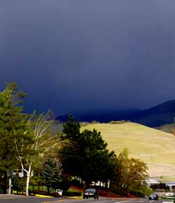 The view of the mountain from Ashland. The mountain is buried under a very dark storm cloud.