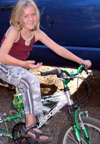 Courtney rides a bike