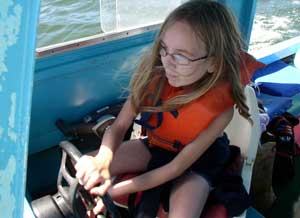 Melanie drives the boat