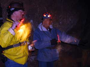 Neto points to a shaft where a pocket of copper ore was found