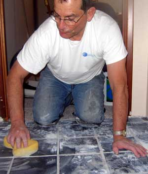 Grouting the tile