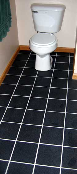 The new toilet and tile are installed