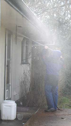 Pressure wash the house
