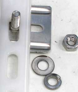 Carriage bolt, flat washer, lock washer and bolt used to secure cover