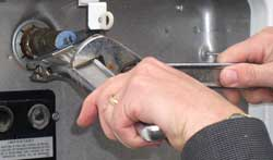 Two wrenches may be needed to remove the valve.